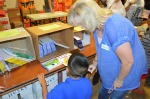 Manos Volunteer and child_books